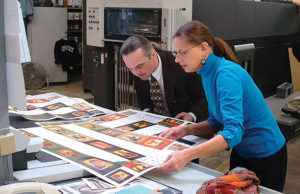 Michael and Nancy Sayre fussing over every detail of a print run.